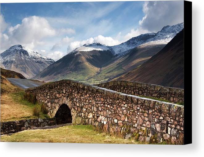 Bridges Canvas Print featuring the photograph Stone Bridge In Mountain Landscape by John Short