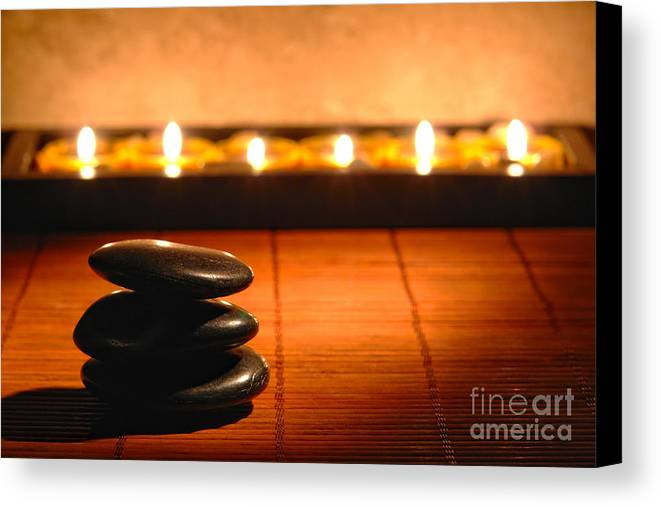 Zen Canvas Print featuring the photograph Stone Cairn And Candles For Quiet Meditation by Olivier Le Queinec