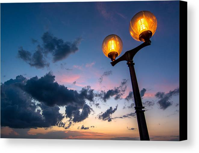 Streetlamp Canvas Print featuring the photograph Streetlamp And Cloudy Nightsky by Andreas Berthold