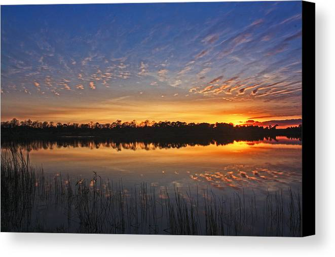 Sunset Canvas Print featuring the photograph Stripe Reflection by Cliff Cammarata