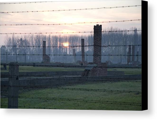 Sunset Canvas Print featuring the photograph Sunset In The Former Death Camp Auschwitz Birkenau Poland by Ronald Jansen