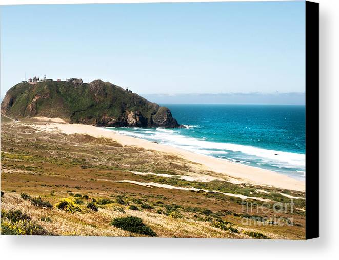 Piedras Blancas Lighthouse Canvas Print featuring the photograph The Rock Of Piedras Blancas Lighthouse In San Simeon Ca by Artist and Photographer Laura Wrede