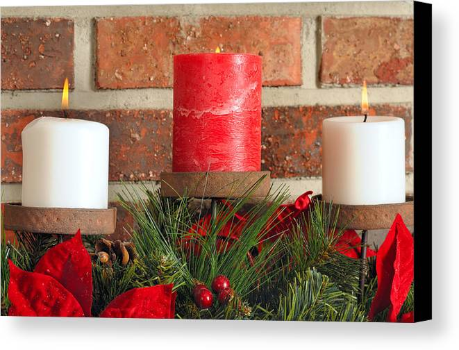 Christmas Canvas Print featuring the photograph Three Christmas Candles by Kenneth Sponsler