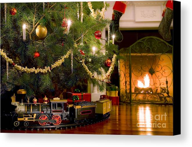 christmas canvas print featuring the photograph toy train under the christmas tree by diane diederich - Train Under Christmas Tree