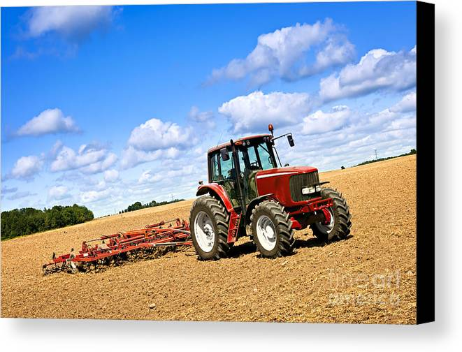 Tractor Canvas Print featuring the photograph Tractor In Plowed Farm Field by Elena Elisseeva