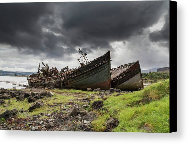 Coast Canvas Print featuring the photograph Two Large Boats Abandoned On The Shore by John Short