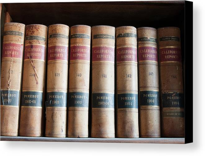 America Canvas Print featuring the photograph Usa, Nevada Old Law Books In Library by Michael Defreitas
