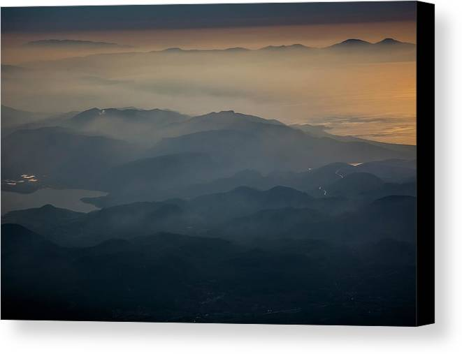 Beauty In Nature Canvas Print featuring the photograph View Of Mountains And Clouds At Sunset by Reynold Mainse