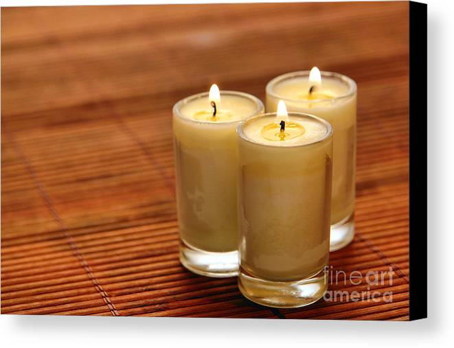 Candles Canvas Print featuring the photograph Votive Candle Burning by Olivier Le Queinec