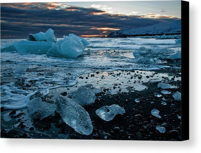 Ice Canvas Print featuring the photograph Washed Ashore by Jim Southwell