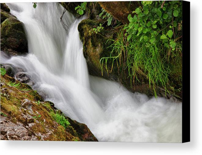 Flowing Canvas Print featuring the photograph Water Flowing Over Rocks Hawick by John Short