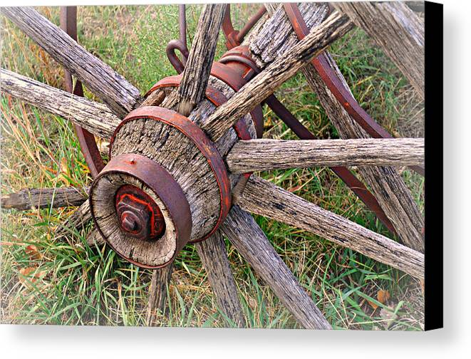 Wagon Wheel Canvas Print featuring the photograph Wheel Of Old by Marty Koch