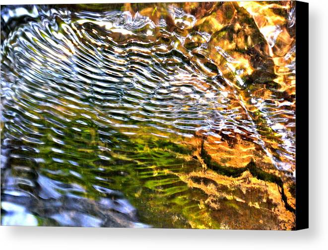 Water Canvas Print featuring the photograph Wind Ripples by David Flitman
