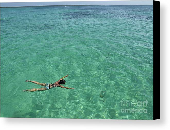People Canvas Print featuring the photograph Woman Snorkeling By Turquoise Sea by Sami Sarkis