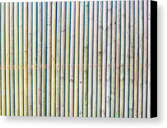 Background Canvas Print featuring the photograph Wooden Poles by Tom Gowanlock