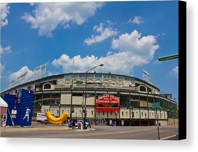 Chicago Canvas Print featuring the photograph Wrigley Field And Clouds by John McGraw