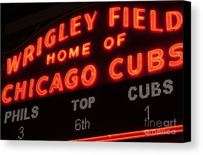 Chicago Canvas Print featuring the photograph Wrigley Field Sign At Night by Paul Velgos