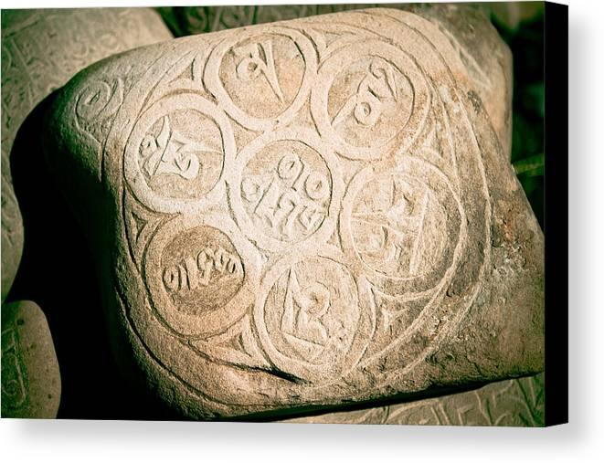Wisdom Canvas Print featuring the photograph writing on the Tibetan language and Sanskrit at stone by Raimond Klavins