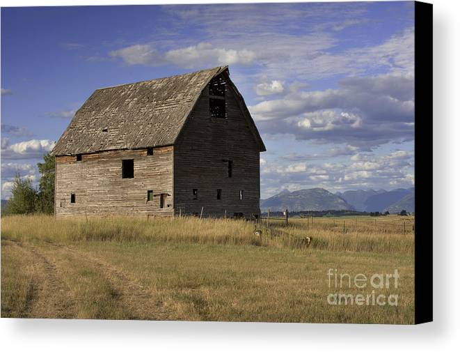Big Sky Canvas Print featuring the photograph Old Big Sky Barn by Sandra Bronstein