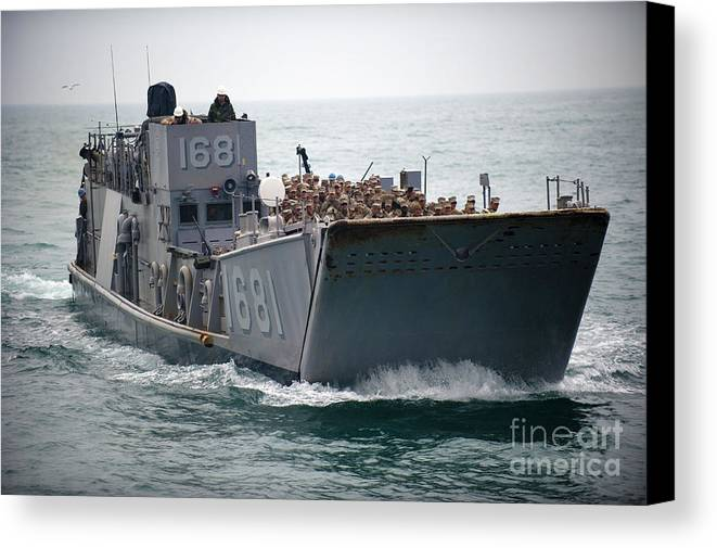 Warship Canvas Print featuring the photograph A Landing Craft Utility Transits by Stocktrek Images