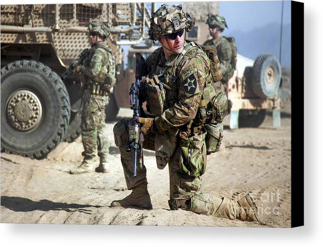 Operation Enduring Freedom Canvas Print featuring the photograph A U.s. Army Soldier Provides Security by Stocktrek Images