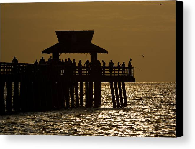 Afternoon Canvas Print featuring the photograph Fishing At Naples Pier by Ed Gleichman