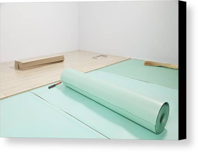 Nobody Canvas Print featuring the photograph Laying A Floor. Rolls Of Underlay Or by Magomed Magomedagaev