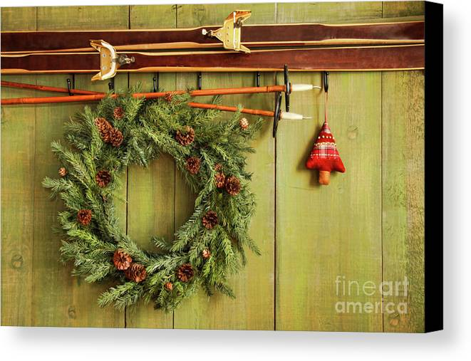 Antique Canvas Print featuring the photograph Old Pair Of Skis Hanging With Wreath by Sandra Cunningham