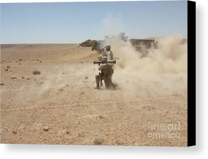 Us Marine Corps Canvas Print featuring the photograph U.s. Marines Fire Several by Stocktrek Images