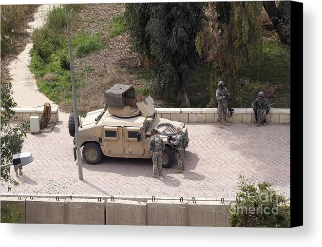 Baghdad Canvas Print featuring the photograph U.s. Military Soldiers Take A Well by Terry Moore
