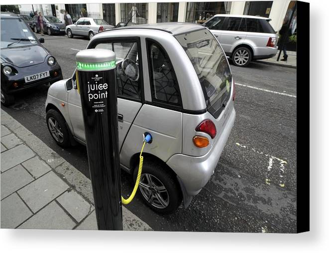 Reva Canvas Print featuring the photograph Recharging An Electric Car by Martin Bond