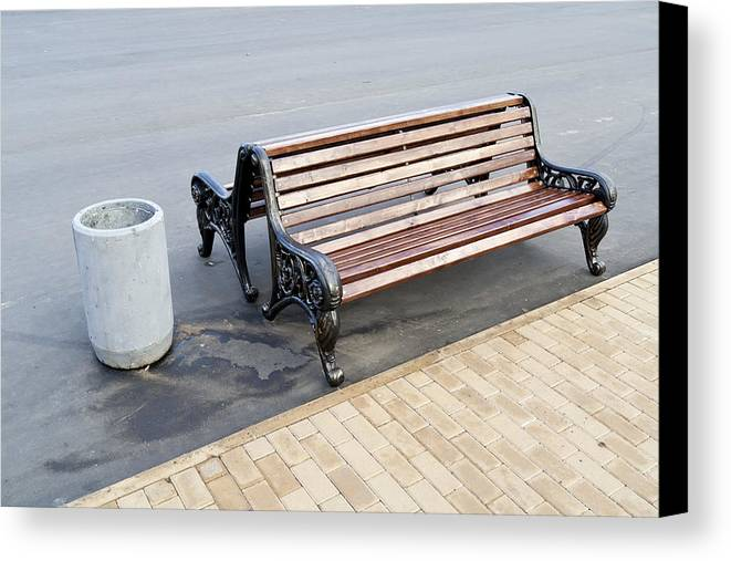 Bench Canvas Print featuring the photograph A Bench To Rest In A Public City Park by Aleksandr Volkov