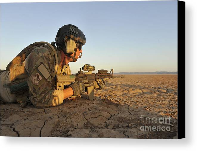 Holding Canvas Print featuring the photograph A Combat Rescue Officer Provides by Stocktrek Images