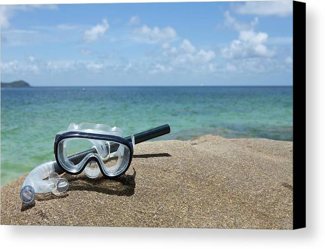 Horizontal Canvas Print featuring the photograph A Diving Mask And Snorkel On A Rock Near The Sea by Caspar Benson