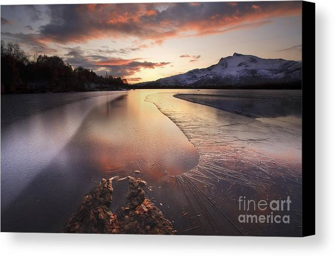 Ice Canvas Print featuring the photograph A Frozen Straumen Lake On Tjeldoya by Arild Heitmann