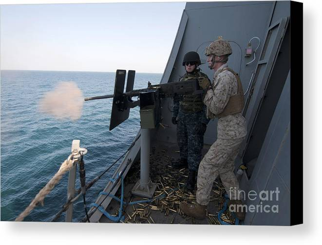 Shooting Canvas Print featuring the photograph A Marine Fires A .50-caliber Machine by Stocktrek Images