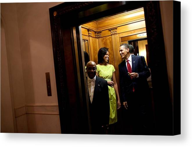 History Canvas Print featuring the photograph A Smiling President Obama Holds by Everett