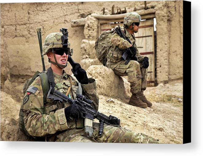 Afghanistan National Police Canvas Print featuring the photograph A Soldier Calls In Description by Stocktrek Images