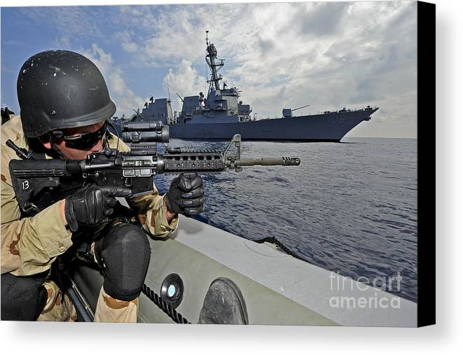 Warship Canvas Print featuring the photograph A Soldier Provides Security In A Rigid by Stocktrek Images