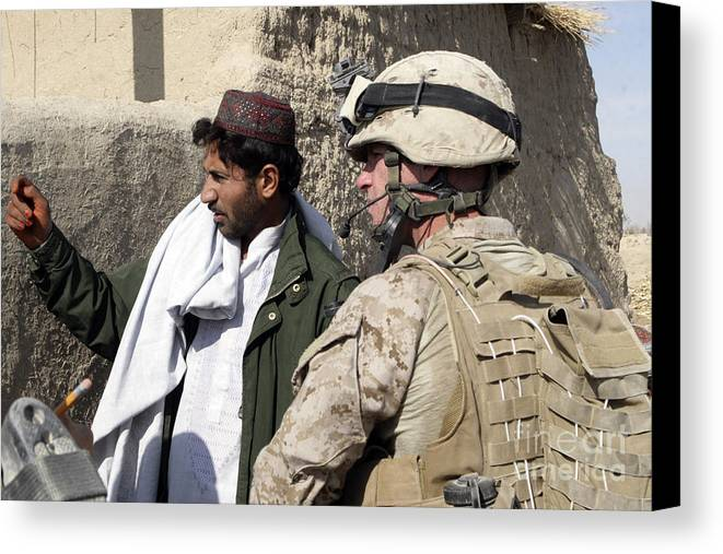 Marines Canvas Print featuring the photograph A Soldier Talks To A Local Villager by Stocktrek Images