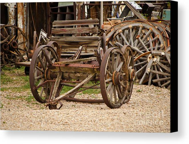 Fine Art Canvas Print featuring the photograph A Wagon And Wheels by Donna Greene