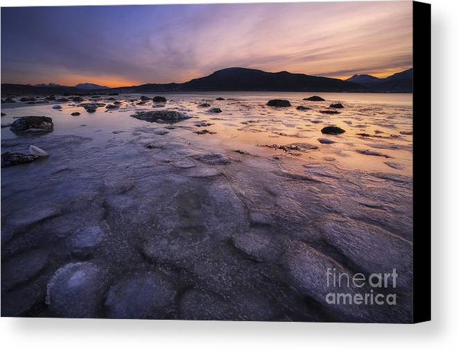 Evenskjer Canvas Print featuring the photograph A Winter Sunset At Evenskjer In Troms by Arild Heitmann