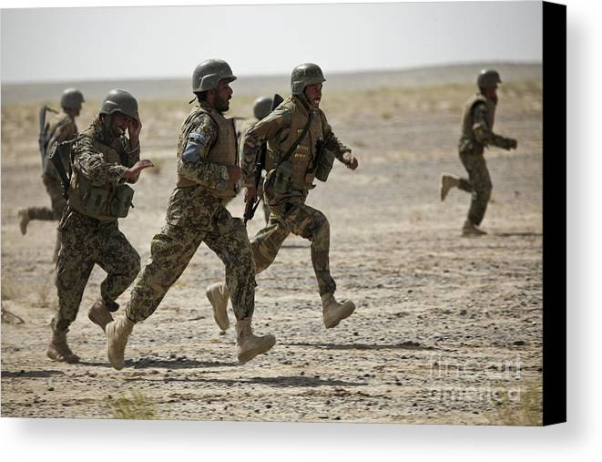 Men Only Canvas Print featuring the photograph Afghan National Army Soldiers Run by Stocktrek Images