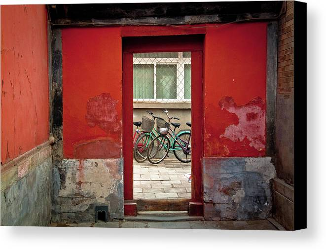 Horizontal Canvas Print featuring the photograph Bicycles In Red Doorway by photo by Sharon Drummond