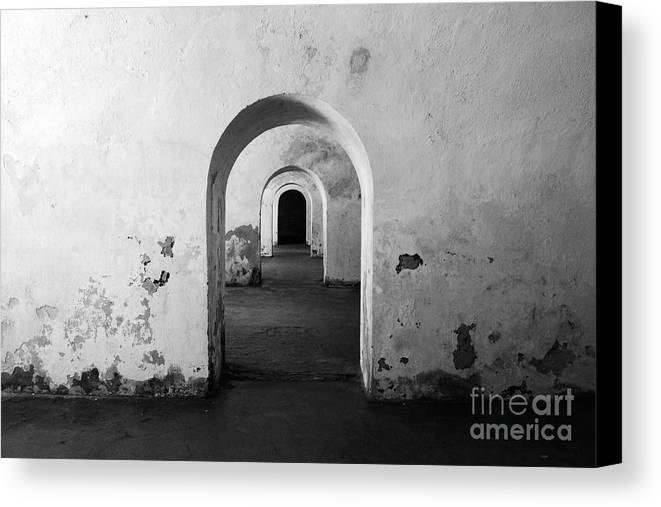 Travelpixpro Puerto Rico Canvas Print featuring the photograph El Morro Fort Barracks Arched Doorways San Juan Puerto Rico Prints Black And White by Shawn O'Brien