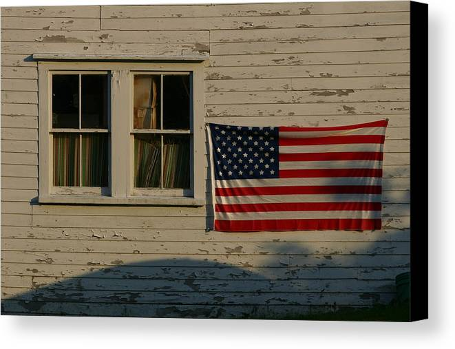 North America Canvas Print featuring the photograph Evening Light On An American Flag by Stephen St. John