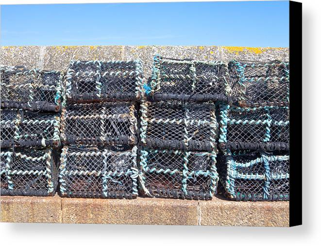 crab Nets Canvas Print featuring the photograph Fishing Baskets by Tom Gowanlock