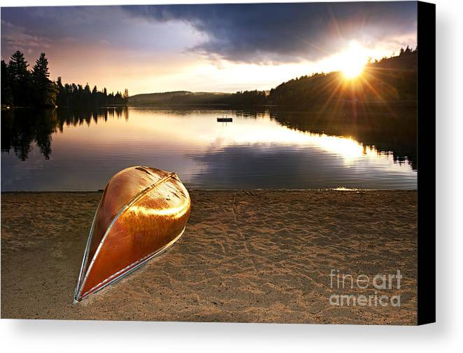 Canoe Canvas Print featuring the photograph Lake Sunset With Canoe On Beach by Elena Elisseeva