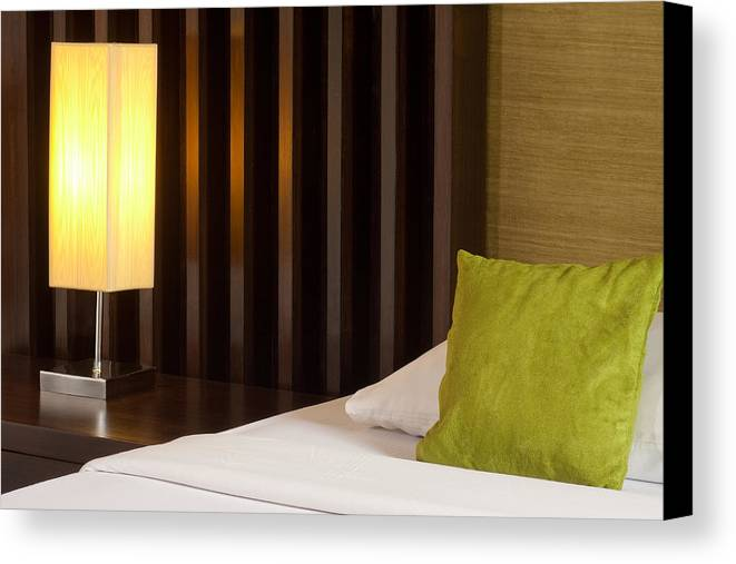 Hotel Canvas Print featuring the photograph Lamp And Bed by Atiketta Sangasaeng