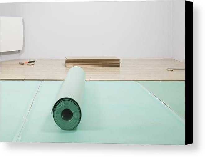 Nobody Canvas Print featuring the photograph Laying A Floor. A Roll Of Underlay Or by Magomed Magomedagaev